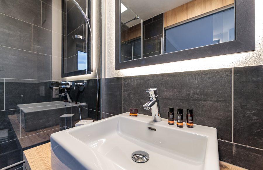 Impressie detail badkamer voor Stockinggut Avenida Leogang